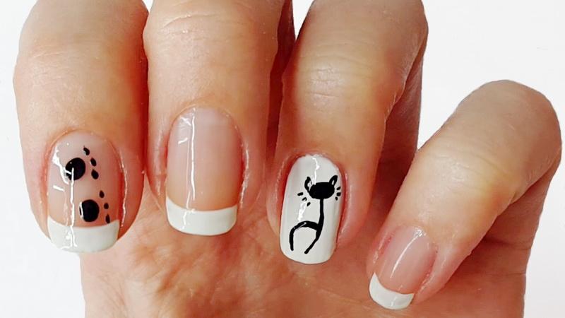 Кошка на ногтях